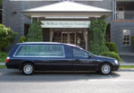 William Matthews funerals hearse in front of funeral chapel
