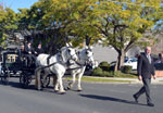 Horsedrawn hearse procession lead by William Matthews.
