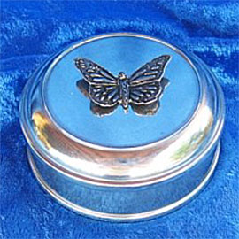 Small pewter urn with decorative pewter butterfly on top