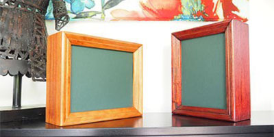 Sample of timber cremation urns with a built in photo frame.